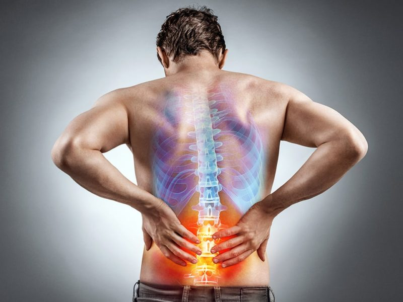 Diagram of man isolating lower back pain and looking for a chiropractor near me.