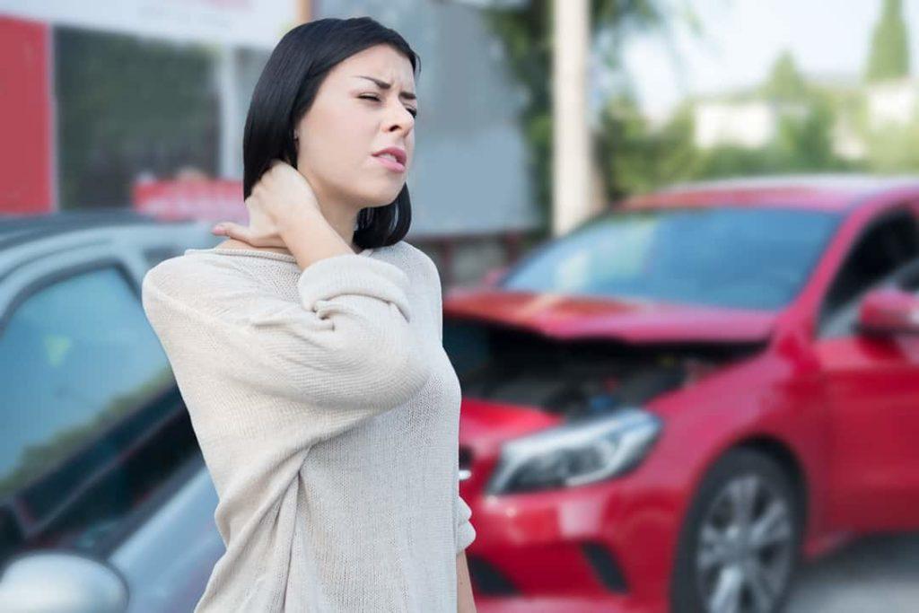 Injured woman feeling neck pain after car crash